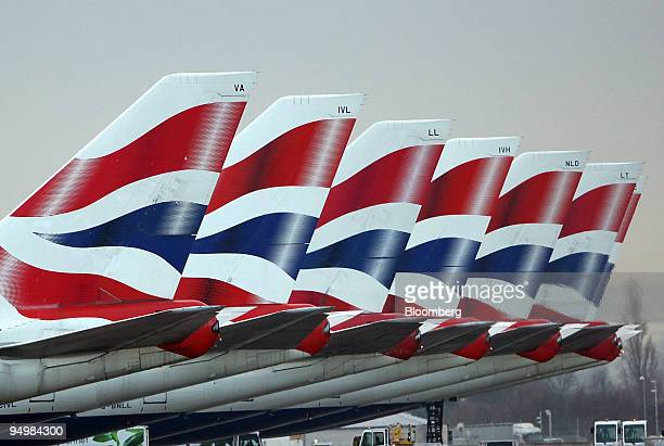 The tail fins of British Airways aircraft are seen at Terminal 5 at Heathrow airport in London UK on Monday Dec 21 2009 British Airways Plc Chief...