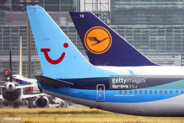 The tail fins of passenger aircraft operated by TUI AG, left, and Deutsche Lufthansa AG, at Frankfurt Airport in Frankfurt, Germany, on Tuesday, July...