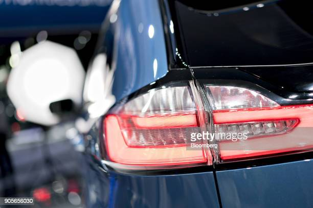 The tail light of a 2019 Ford Motor Co Edge ST sport utility vehicle is seen during the 2018 North American International Auto Show in Detroit...