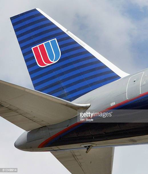 The tail of a United Airlines jet heading to O'Hare International Airport in Chicago is seen in the skies August 31 2004 over Bensenville Illinois...