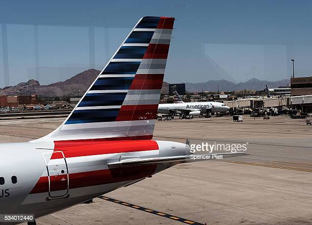 The tail of an American Airlines aircraft sits on a Phoenix runway on May 24 2016 in New York City The Transportation Security Administration has...