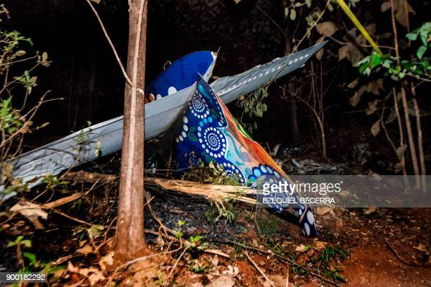 The tail of the burned fuselage of a small plane that crashed is seen in Guanacaste Corozalito Costa Rica on December 31 2017 Ten Americans flying...