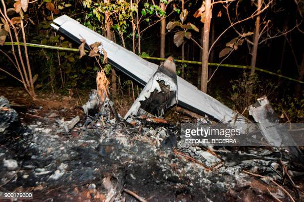 The tail of the burned fuselage of a small plane that crashed rests near trees in Guanacaste Corozalito Costa Rica on December 31 2017 Ten Americans...