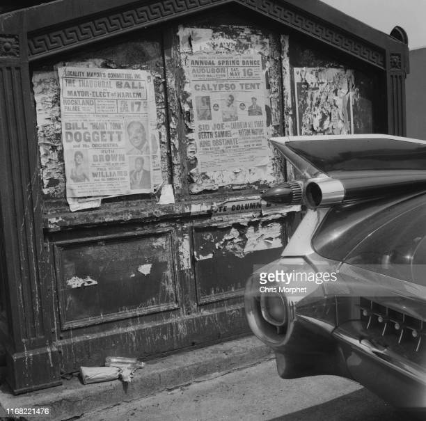 The tailfin of a 1959 Cadillac Eldorado parked in New York 1964 In the background are posters for concerts at the Rockland Palace by Bill Doggett...
