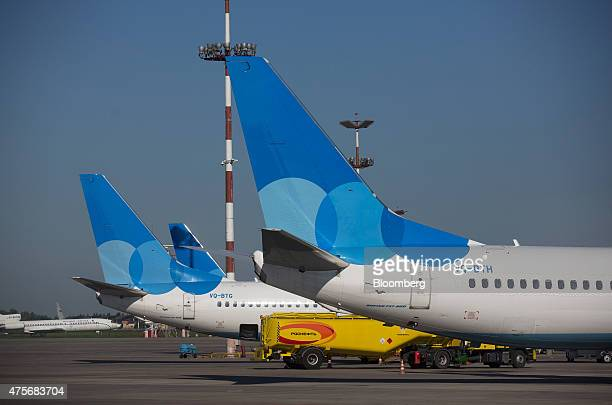 The tailfins of passenger jets operated by Pobeda Airlines a lowcost unit of Aeroflot Russian Airlines OJSC stand on the tarmac at Vnukovo...
