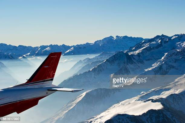 The Tailplane of an Airplane flying over snowcapped mountains