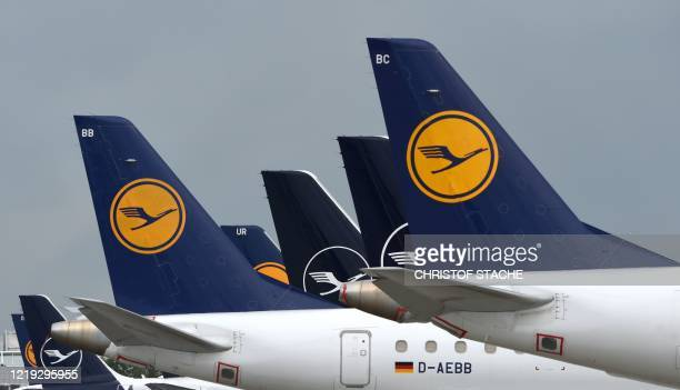 """The tails of aircraft of the German airline Lufthansa are seen at the """"Franz-Josef-Strauss"""" airport in Munich, southern Germany, on June 11, 2020. -..."""