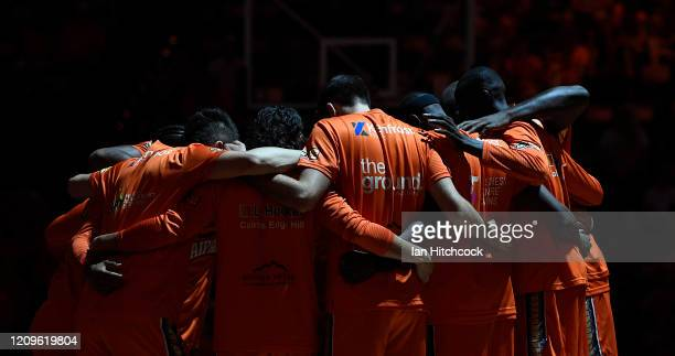 The Taipans gather in a huddle before the start of game two of the NBL Semi Final series between the Cairns Taipans and the Perth Wildcats at the...