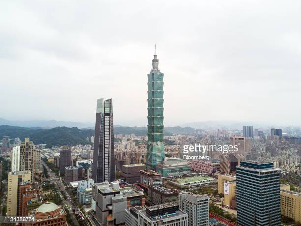 The Taipei 101 building center stands in this aerial photograph taken in Taipei Taiwan on Saturday March 30 2019 According to Knight Frank's...