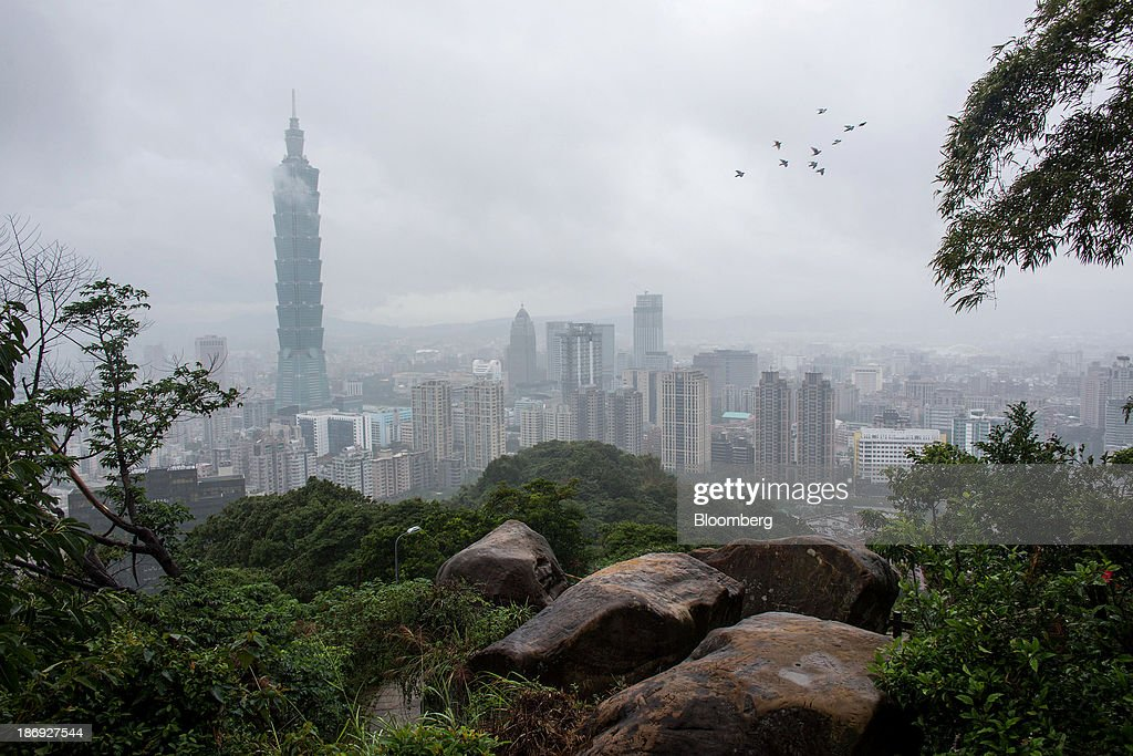 The Taipei 101 building, left, stands among residential and commercial buildings in Taipei, Taiwan, on Monday, Nov. 4, 2013. Taiwans five-year bonds gained for the first time in four days, lowering the yield from a three-week high, after a report showed inflation cooled. The local dollar strengthened. Photographer: Lam Yik Fei/Bloomberg via Getty Images