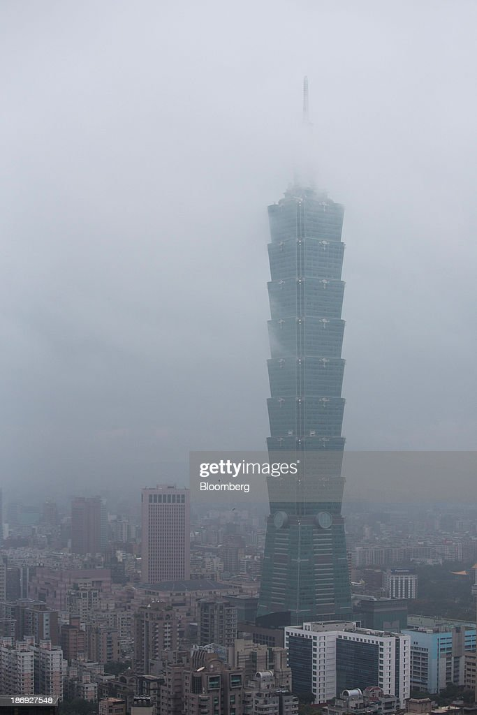 The Taipei 101 building stands among residential and commercial buildings in Taipei, Taiwan, on Monday, Nov. 4, 2013. Taiwans five-year bonds gained for the first time in four days, lowering the yield from a three-week high, after a report showed inflation cooled. The local dollar strengthened. Photographer: Lam Yik Fei/Bloomberg via Getty Images