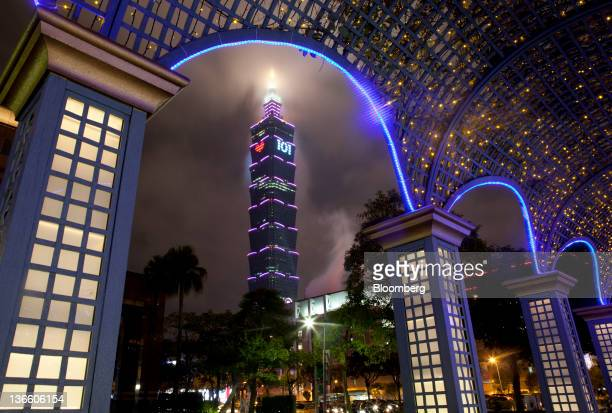 The Taipei 101 building stands behind financial buildings in Taipei, Taiwan, on Sunday, Jan. 8, 2012. Taiwan holds presidential elections on Jan. 14....
