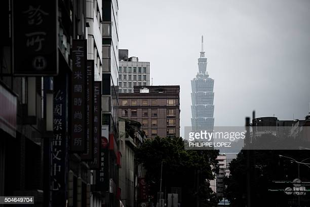 The Taipei 101 tower formerly known as the Taipei World Financial Center is seen from a street in Taipei on January 12 2016 Taiwan's voters angry at...