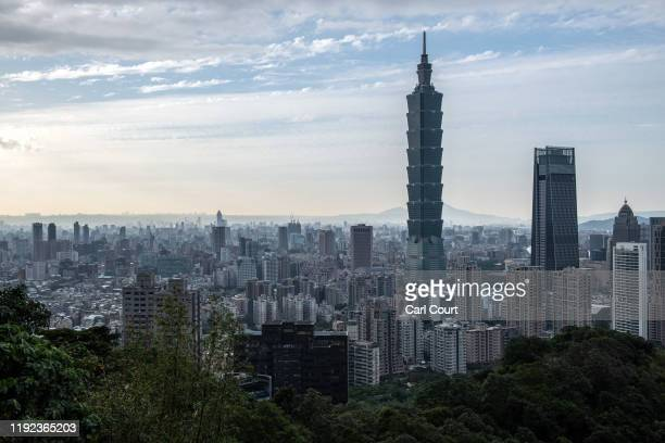 The Taipei 101 tower once the worlds tallest building and the Taipei skyline are pictured from the top of Elephant Mountain on January 7 2020 in...