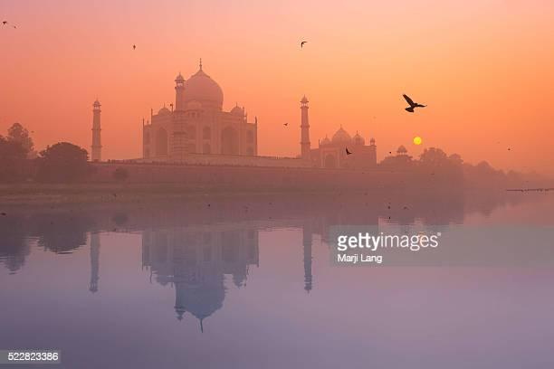 The Taj Mahal by the Yamuna river on a misty evening in Agra Uttar Pradesh India