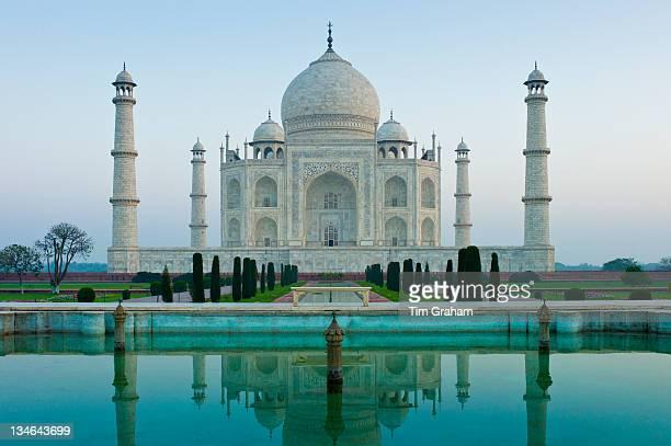The Taj Mahal mausoleum southern view with reflecting pool and cypress trees Uttar Pradesh India