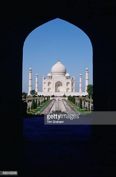The Taj Mahal photographed through an arch Agra India