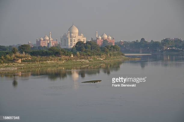 The Taj Mahal the most beautiful building of the world seen from across the river Yamuna