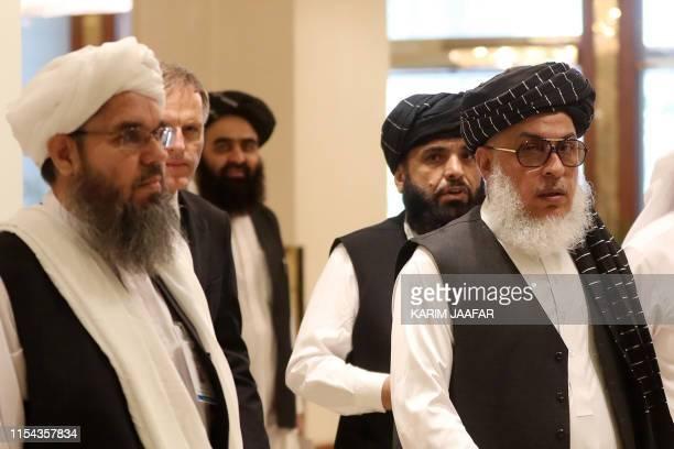 The Taliban's former envoy to Saudi Arabia Shahabuddin Delawar arrives with Taliban negotiator Abbas Stanikzai along with Taliban Qatar spokesman...