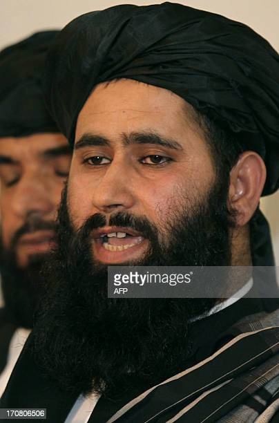 The Talibans office spokesman Mohammed Naim speaks during a press conference at the opening ceremony of the new Taliban political office in Doha on...