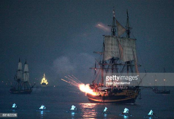 The Tall Ship Grand Turk playing the part of Admiral Nelson's flagship HMS Victory fires a broadside during a reenactment of the Battle of Trafalgar...