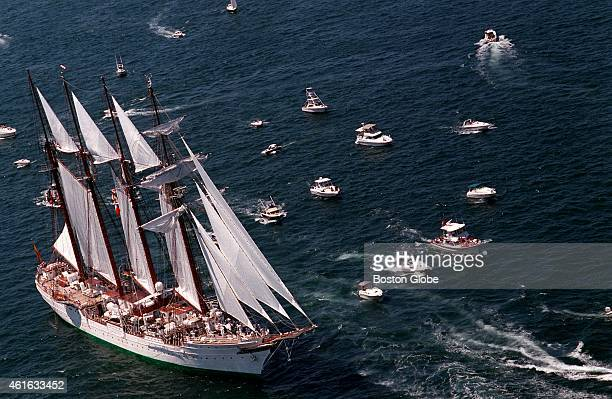 The Tall Ship Juan Sebastian De Elcano makes its way into Newport Harbor in Rhode Island Sunday morning as the ships converge in yet one more port as...