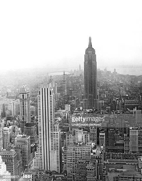 The tallest building in the world, the Empire State Building, towers over midtown Manhattan, New York, New York, late 1930s. Finished in 1932, the...