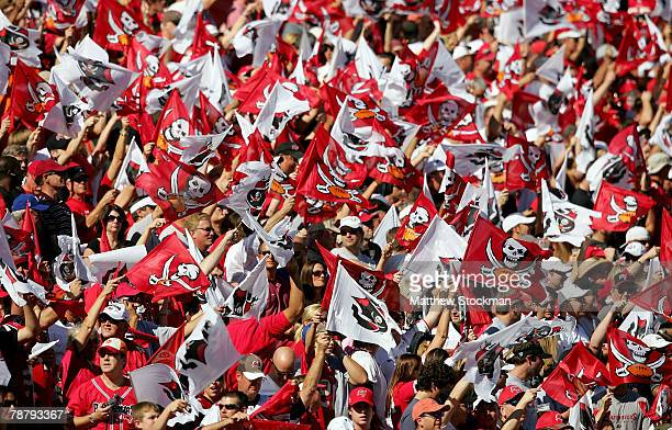 The Tampa Bay Buccaneers fans cheer on their team during the NFC Wild Card game against the New York Giants at Raymond James Stadium on January 6,...