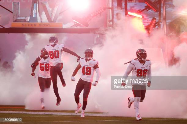 The Tampa Bay Buccaneers take the field before Super Bowl LV against the Kansas City Chiefs at Raymond James Stadium on February 07, 2021 in Tampa,...