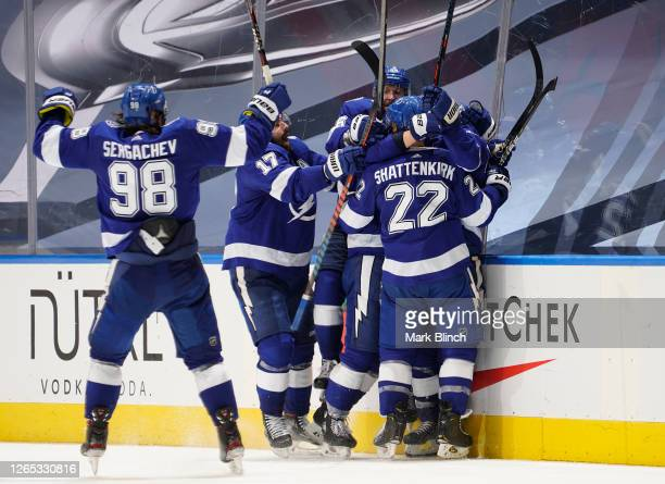 The Tampa Bay Lightning celebrate after Brayden Point scored the game winning goal at 10:27 in the fifth overtime to win 3-2 in Game One of the...