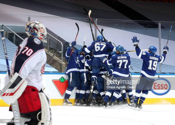 The Tampa Bay Lightning celebrate after Brayden Point scored the game winning goal at 10:27 in the fifth overtime to win 3-2 over the Columbus Blue...