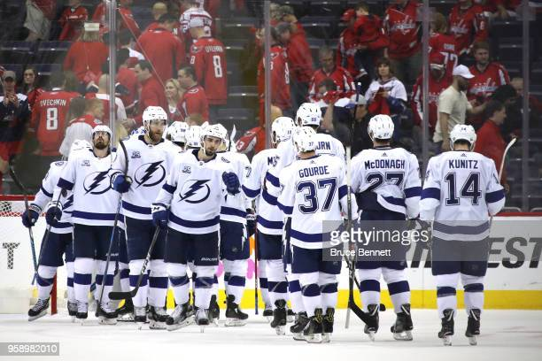 The Tampa Bay Lightning celebrate after defeating the Washington Capitals in Game Three of the Eastern Conference Finals during the 2018 NHL Stanley...