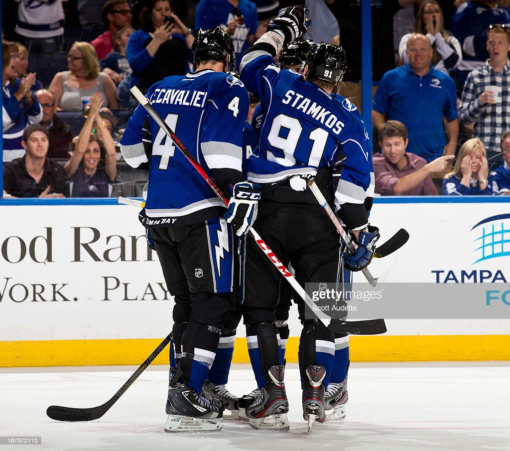 The Tampa Bay Lightning celebrate after Martin St. Louis #26 scores his third goal during the game against the Toronto Maple Leafs 5-2 at the Tampa Bay Times Forum on April 24, 2013 in Tampa, Florida.