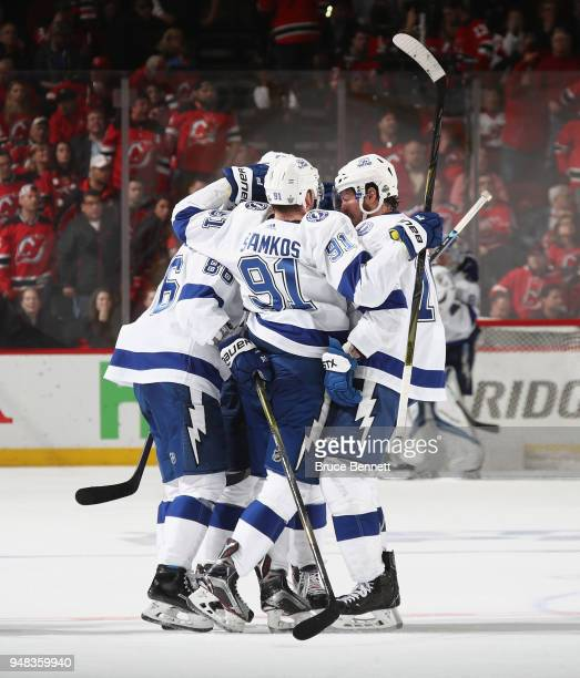 The Tampa Bay Lightning celebrate an empty net goal by Nikita Kucherov against the New Jersey Devils in Game Four of the Eastern Conference First...