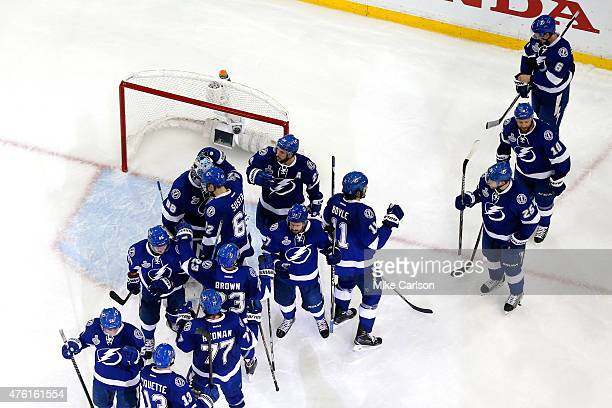 The Tampa Bay Lightning celebrate defeating the Chicago Blackhawks 4 to 3 in Game Two of the 2015 NHL Stanley Cup Final at Amalie Arena on June 6...