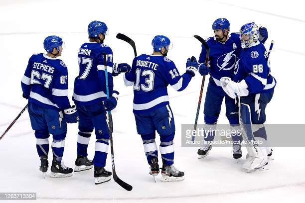 The Tampa Bay Lightning celebrate their win in the overtime shoot-out against the Washington Capitals in Game One of the Eastern Conference...