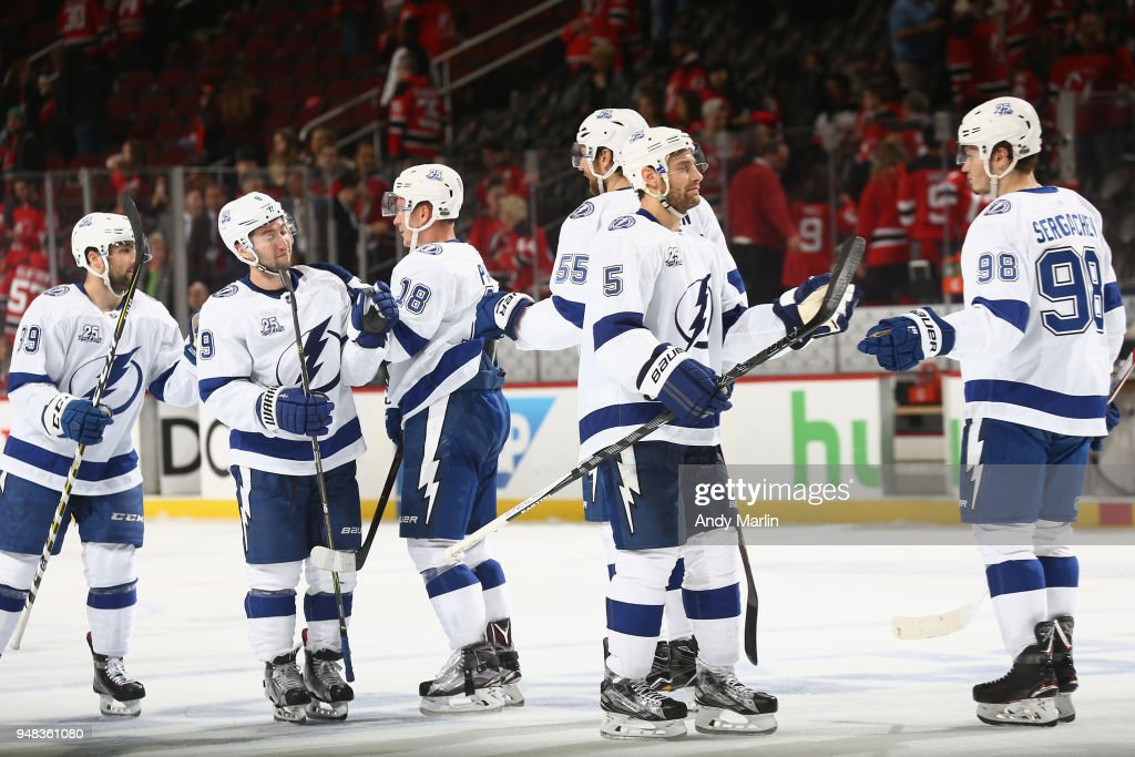 The Tampa Bay Lightning celebrate their win over the New Jersey Devils in Game Four of the Eastern Conference First Round during the 2018 NHL Stanley Cup Playoffs at Prudential Center on April 18, 2018 in Newark, New Jersey. The Lightning defeated the Devils 3-1.