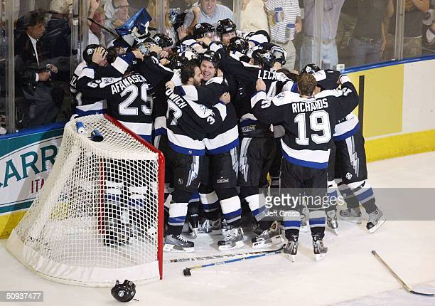 The Tampa Bay Lightning celebrate winning the Stanley Cup after defeating the Calgary Flames 21 in game seven of the NHL Stanley Cup Finals on June 7...