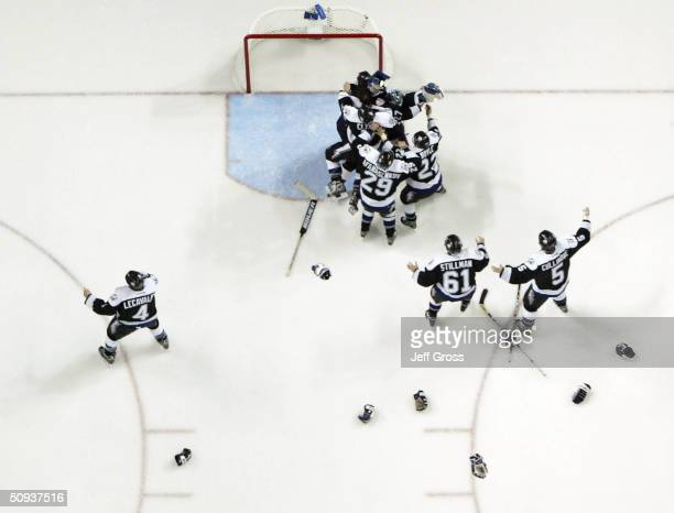 The Tampa Bay Lightning celebrate with teammate goaltender Nikolai Khabibulin after defeating the Calgary Flames 21 in game seven of the NHL Stanley...
