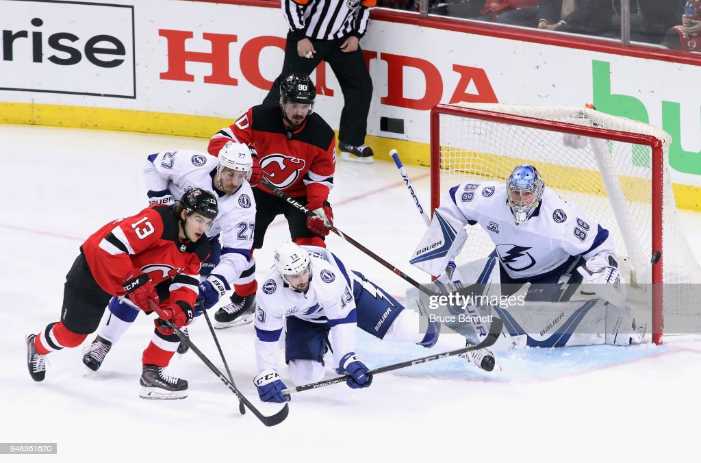 The Tampa Bay Lightning defend against the New Jersey Devils as the puck bounces past the right post in Game Four of the Eastern Conference First Round during the 2018 NHL Stanley Cup Playoffs at the Prudential Center on April 18, 2018 in Newark, New Jersey. The Lightning defeated the Devils 3-1.