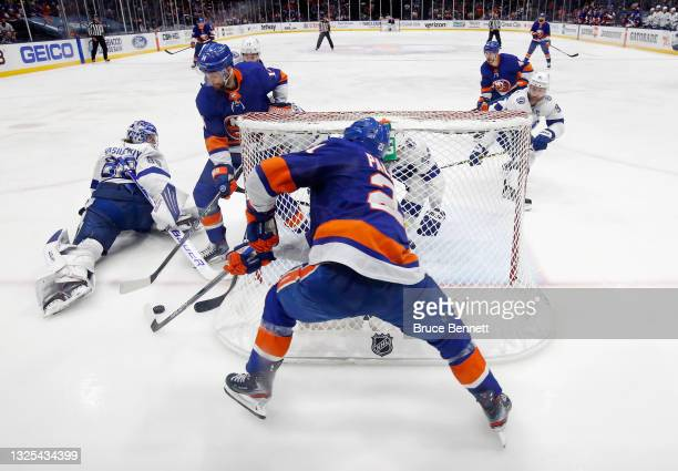 The Tampa Bay Lightning defend against Travis Zajac and Kyle Palmieri of the New York Islanders in Game Six of the NHL Stanley Cup Semifinals during...