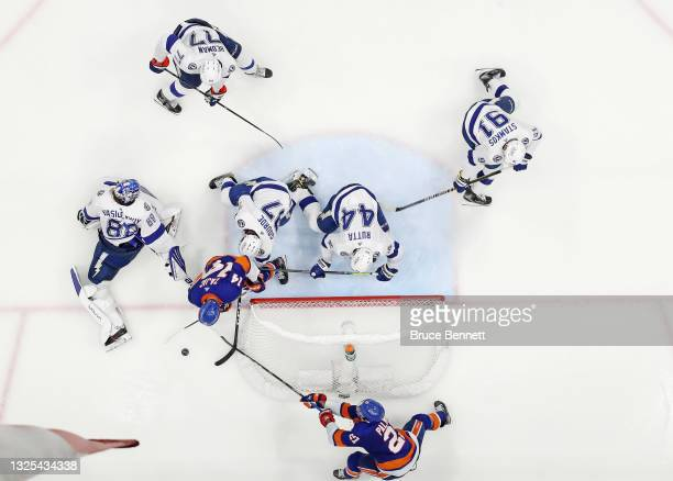 The Tampa Bay Lightning defend against Travis Zajac of the New York Islanders in Game Six of the NHL Stanley Cup Semifinals during the 2021 NHL...