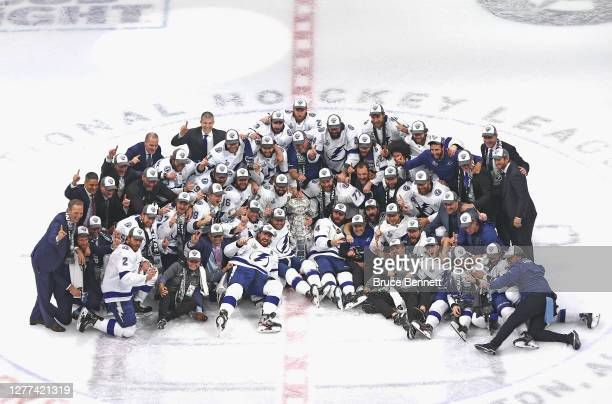 The Tampa Bay Lightning pose with the Stanley Cup 1following the series-winning victory over the Dallas Stars in Game Six of the 2020 NHL Stanley Cup...