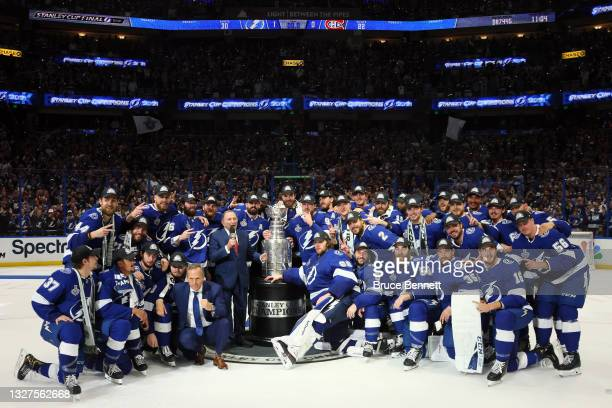 The Tampa Bay Lightning pose with the Stanley Cup after defeating the Montreal Canadiens 1-0 in Game Five to win the 2021 NHL Stanley Cup Final at...