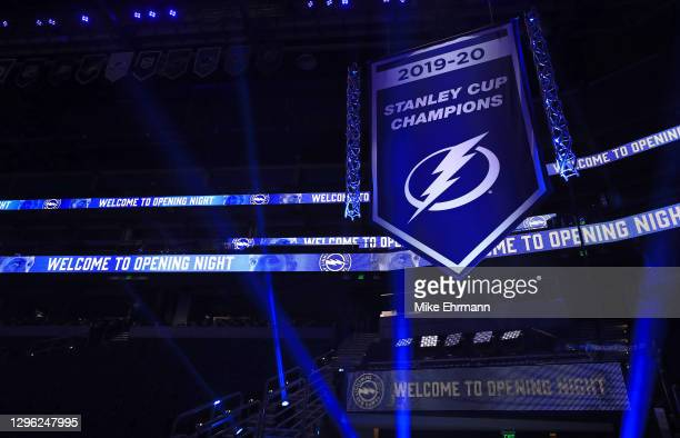 The Tampa Bay Lightning raise the banner celebrating winning the Stanley Cup for the 2019-20 NHL season during a game against the Chicago Blackhawks...