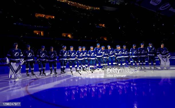 The Tampa Bay Lightning watch the banner being raised celebrating winning the Stanley Cup for the 2019-20 NHL season during a game against the...