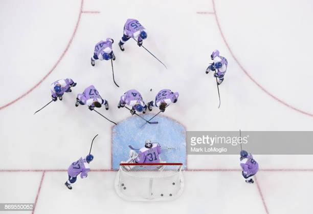 The Tampa Bay Lightning wear lavender for Hockey Fights Cancer night against the New York Rangers during the pregame warm ups at Amalie Arena on...