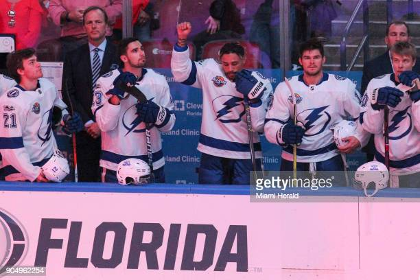 The Tampa Bay Lightning's JT Brown protests during the national anthem before the start of a game against the Florida Panthers at the BBT Center in...