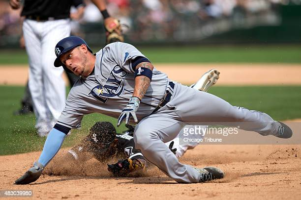 The Tampa Bay Rays' Asdrubal Cabrera foreground dives for first base as Chicago White Sox shortstop Alexei Ramirez chases him down during the seventh...