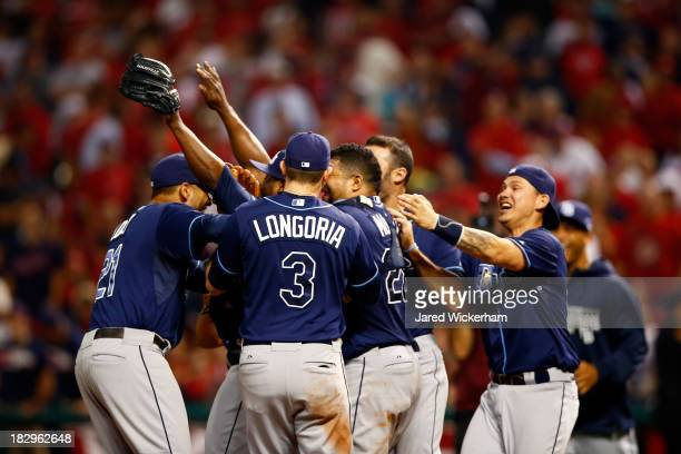 The Tampa Bay Rays celebrate defeating the Cleveland Indians in the American League Wild Card game at Progressive Field on October 2, 2013 in...